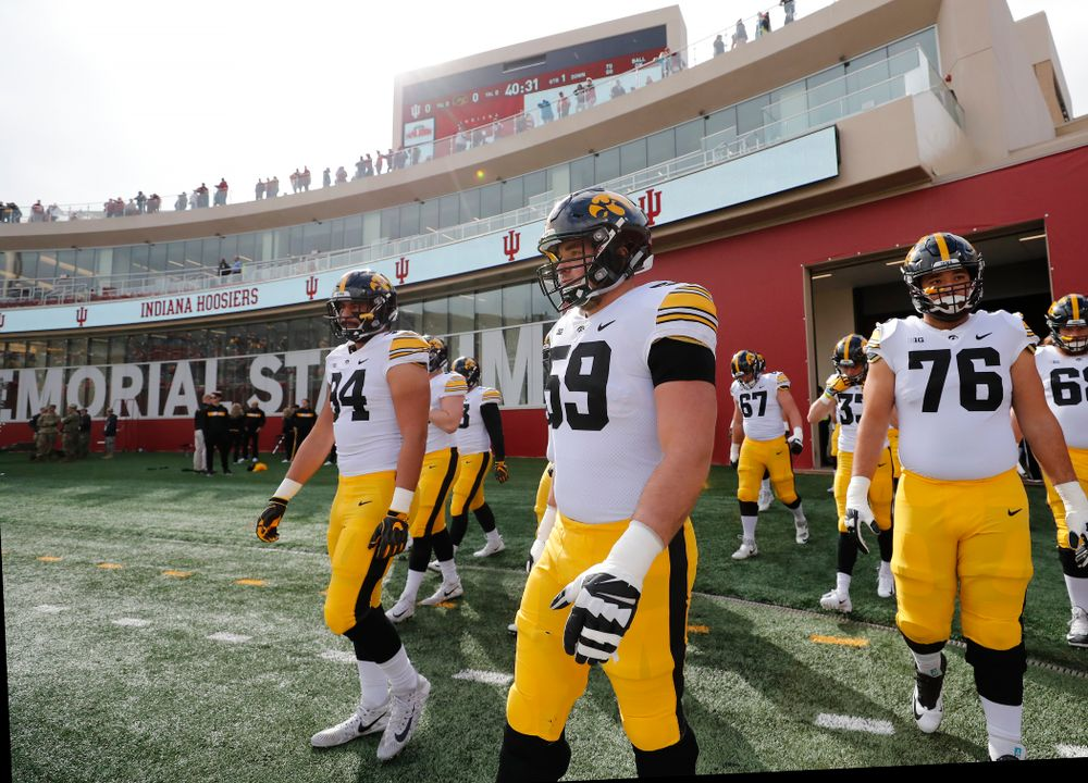 Iowa Hawkeyes offensive lineman Ross Reynolds (59) and defensive end A.J. Epenesa (94) against the Indiana Hoosiers Saturday, October 13, 2018 at Memorial Stadium, in Bloomington, Ind. (Brian Ray/hawkeyesports.com)