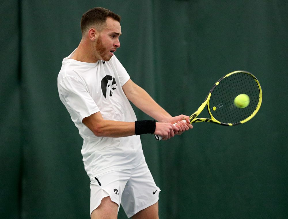 Iowa's Kareem Allaf returns a shot during his singles match at the Hawkeye Tennis and Recreation Complex in Iowa City on Sunday, February 16, 2020. (Stephen Mally/hawkeyesports.com)