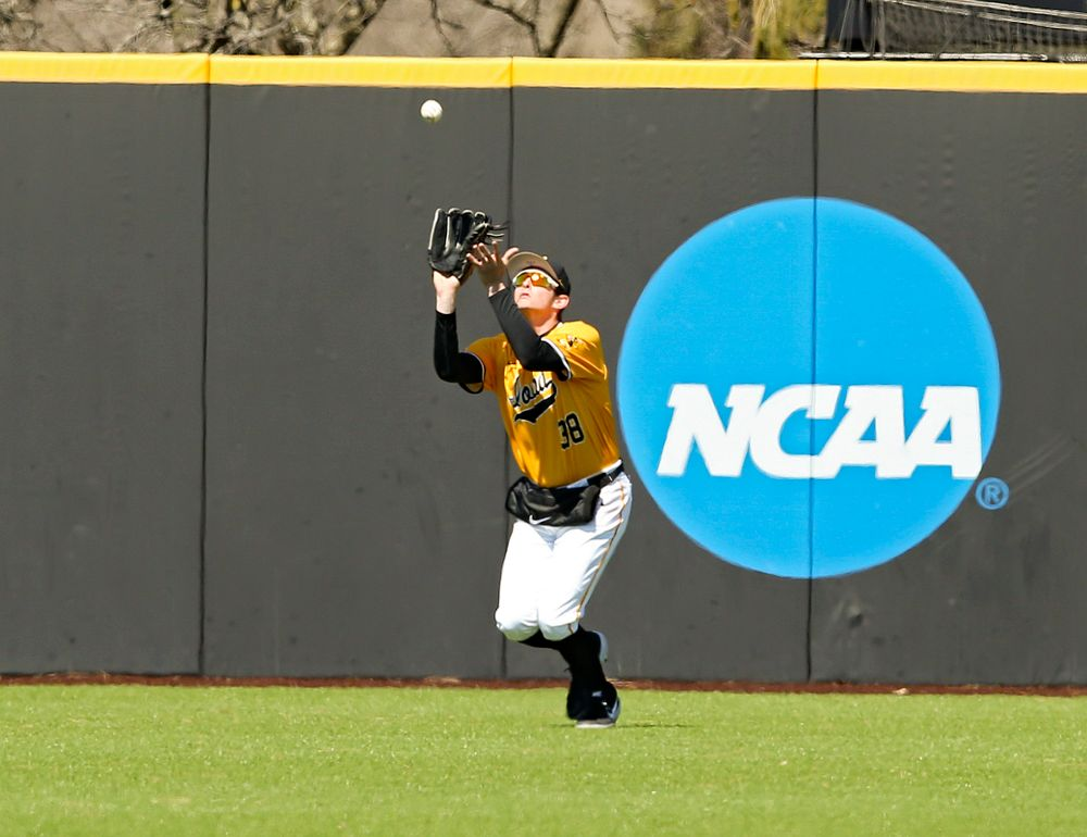 Iowa Hawkeyes  left fielder Trenton Wallace (38) pulls in a fly ball for an out during the first inning against Illinois at Duane Banks Field in Iowa City on Sunday, Mar. 31, 2019. (Stephen Mally/hawkeyesports.com)