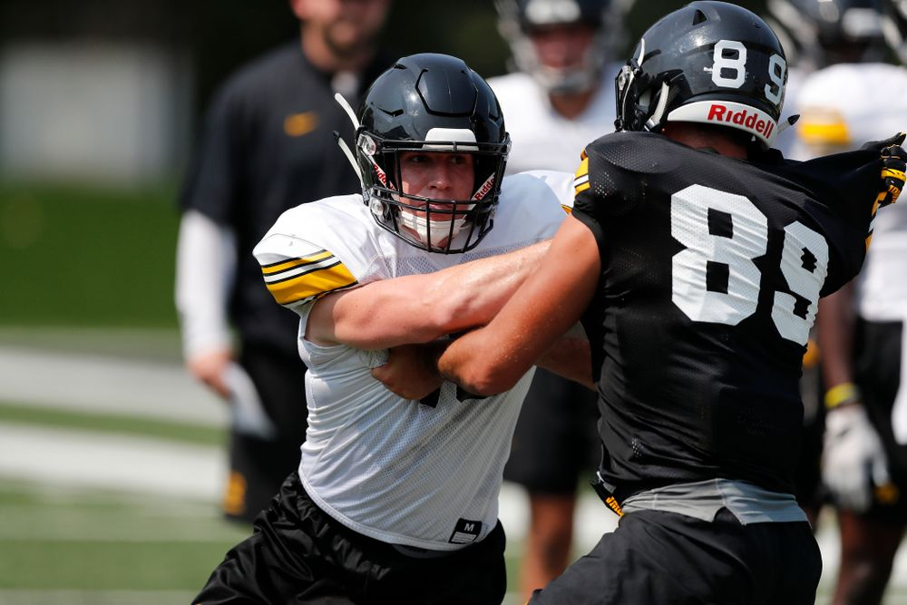 Iowa Hawkeyes defensive back John Milani (18) and wide receiver Nico Ragaini (89) during fall camp practice No. 9 Friday, August 10, 2018 at the Kenyon Practice Facility. (Brian Ray/hawkeyesports.com)