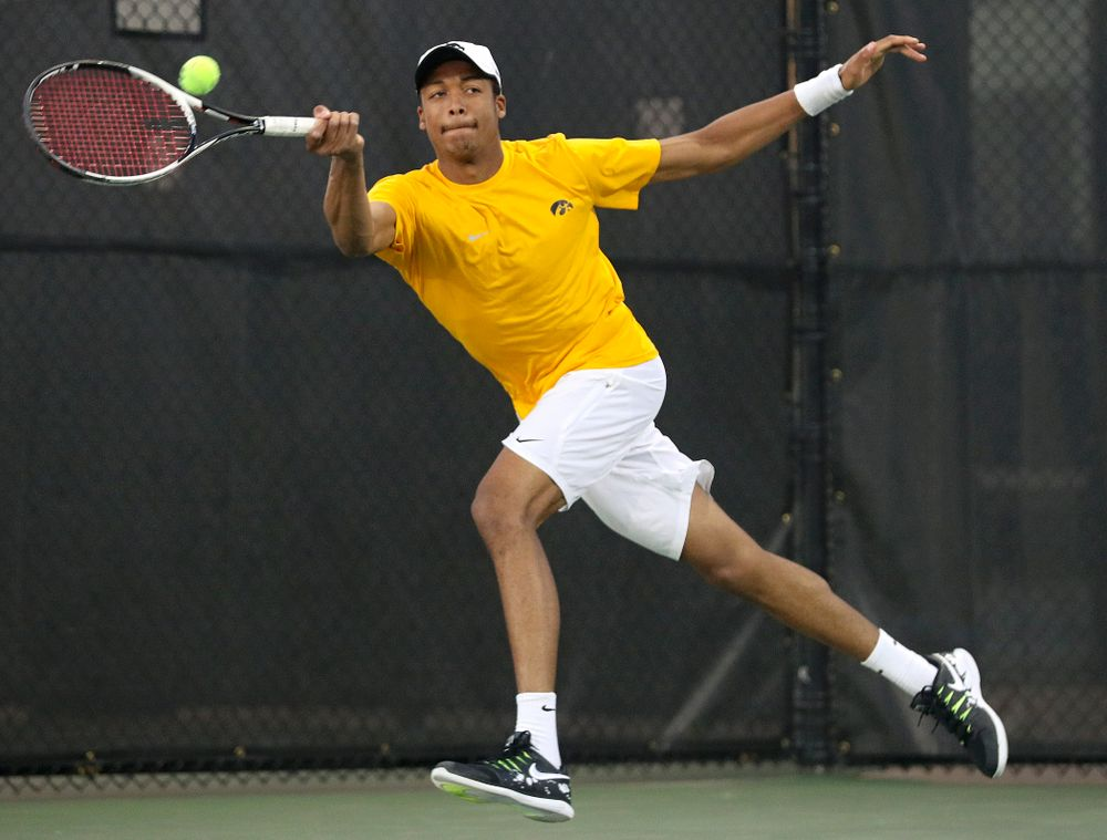 Iowa's Oliver Okonkwo during his match again Michigan State at the Hawkeye Tennis and Recreation Complex in Iowa City on Friday, Apr. 19, 2019. (Stephen Mally/hawkeyesports.com)