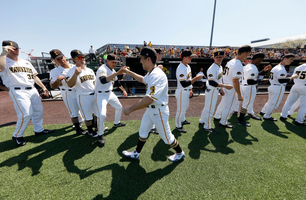 Iowa All American Wrestler Michael Kemerer throws out a first pitch before the Iowa Hawkeyes game against the Oklahoma State Cowboys Saturday, May 5, 2018 at Duane Banks Field. (Brian Ray/hawkeyesports.com)