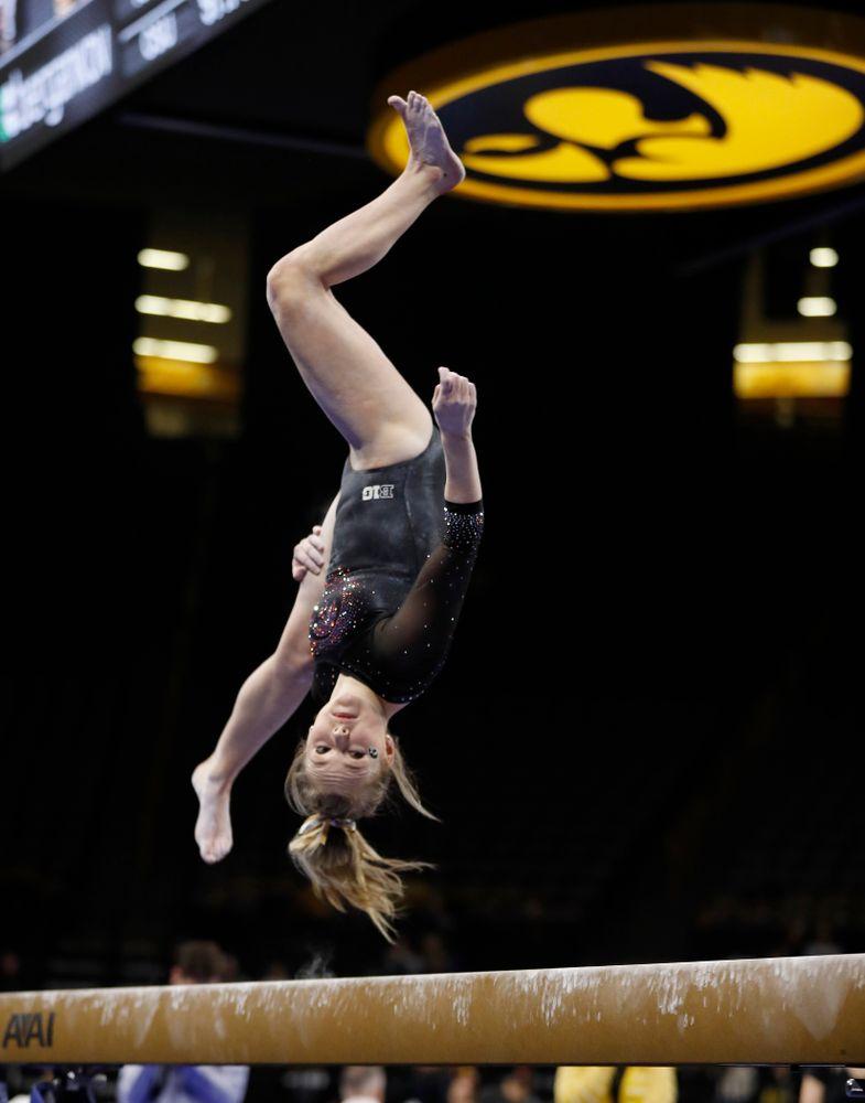 Charlotte Sullivan competes on the beam