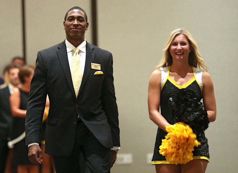 2019 University of Iowa Athletics Hall of Fame inductee Jeremy Allen walks to his seat with a Spirit Squad member during the Hall of Fame Induction Ceremony at the Coralville Marriott Hotel and Conference Center in Coralville on Friday, Aug 30, 2019. (Stephen Mally/hawkeyesports.com)