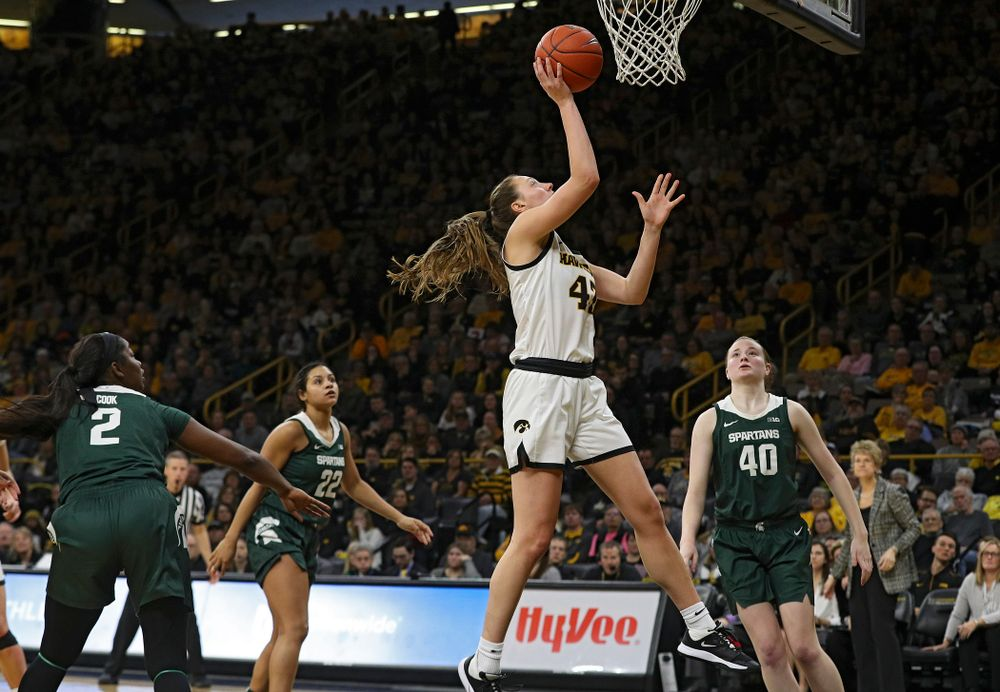 Iowa Hawkeyes forward Amanda Ollinger (43) makes a basket during the third quarter of their game at Carver-Hawkeye Arena in Iowa City on Sunday, January 26, 2020. (Stephen Mally/hawkeyesports.com)