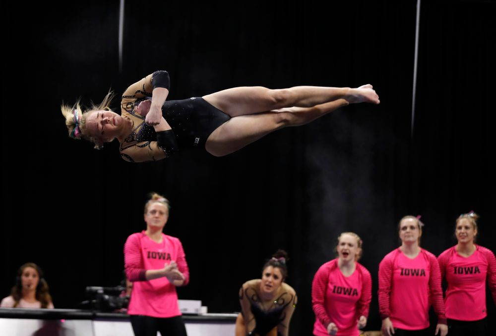 Iowa's Charlotte Sullivan competes on the floor