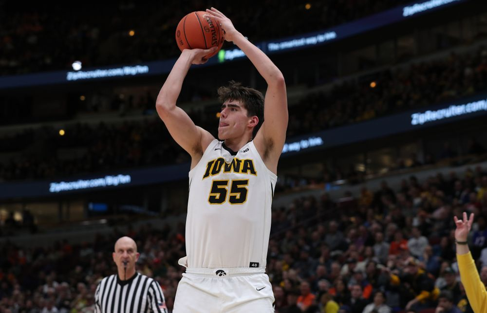 Iowa Hawkeyes forward Luka Garza (55) against the Illinois Fighting Illini in the 2019 Big Ten Men's Basketball Tournament Thursday, March 14, 2019 at the United Center in Chicago. (Brian Ray/hawkeyesports.com)