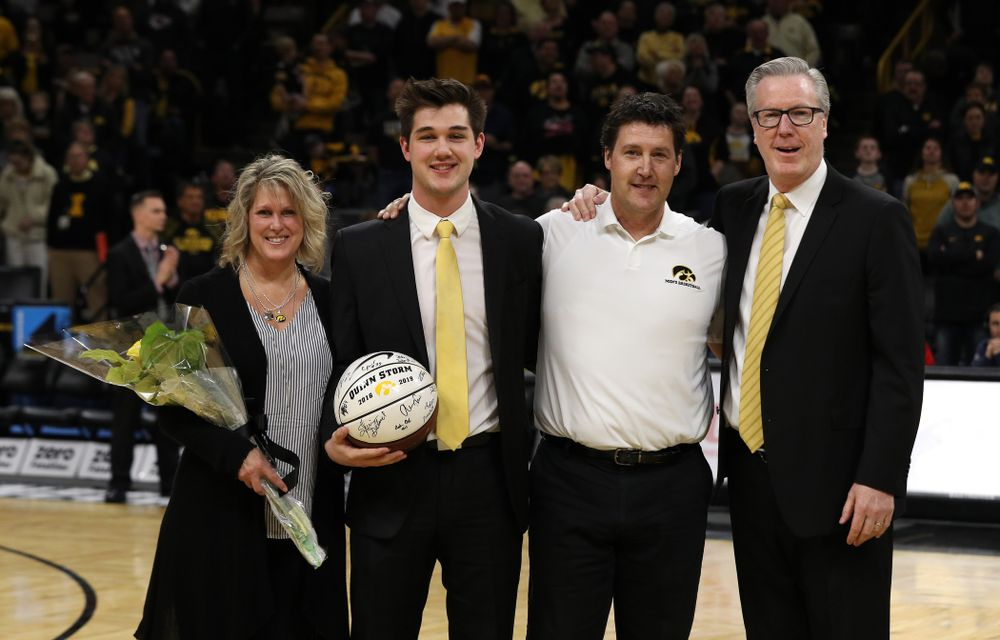 Senior Manager Quinn Storm stands with Iowa Hawkeyes head coach Fran McCaffery and his family during senior day activities before their game against the Rutgers Scarlet Knights  Saturday, March 2, 2019 at Carver-Hawkeye Arena. (Brian Ray/hawkeyesports.com)