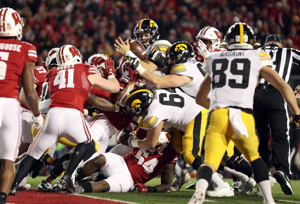 Iowa Hawkeyes quarterback Nate Stanley (4) against the Wisconsin Badgers Saturday, November 9, 2019 at Camp Randall Stadium in Madison, Wisc. (Brian Ray/hawkeyesports.com)