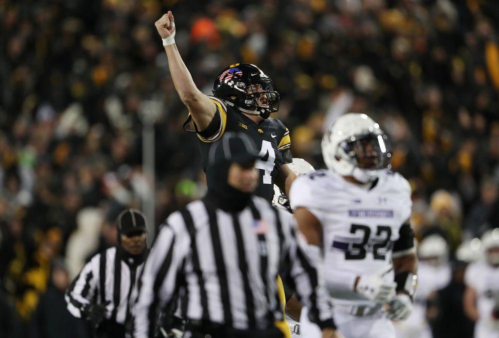 Iowa Hawkeyes quarterback Nate Stanley (4) celebrates a touchdown against the Northwestern Wildcats Saturday, November 10, 2018 at Kinnick Stadium. (Brian Ray/hawkeyesports.com)
