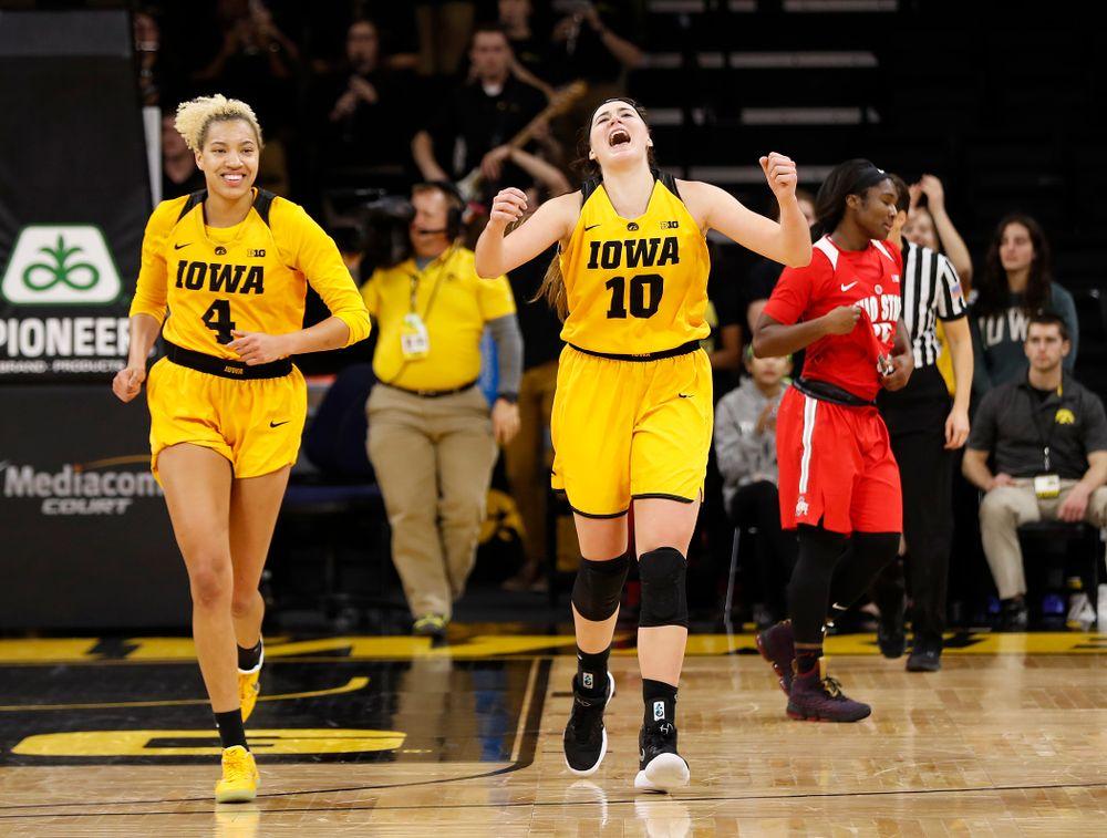 Iowa Hawkeyes forward Megan Gustafson (10 and forward Chase Coley (4)