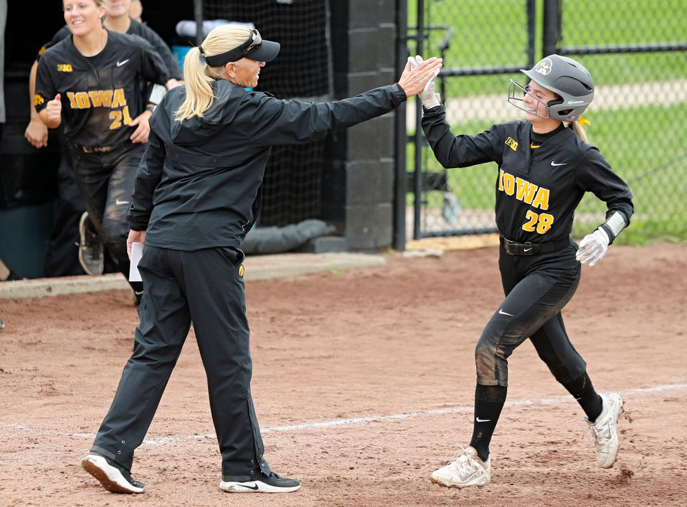 Iowa's Taylor Ryan (28) gets a high-five from head coach Renee Gillispie as she rounds the bases after DoniRae Mayhew's (not pictured) home run during the sixth inning of their game against Iowa Softball vs Indian Hills Community College at Pearl Field in Iowa City on Sunday, Oct 6, 2019. (Stephen Mally/hawkeyesports.com)