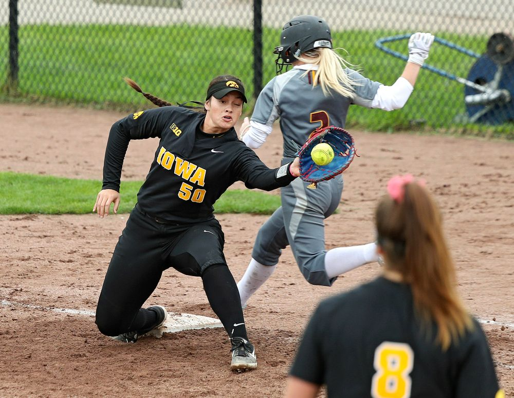 Iowa infielder Kalena Burns (50) pulls in a throw during the seventh inning of their game against Iowa Softball vs Indian Hills Community College at Pearl Field in Iowa City on Sunday, Oct 6, 2019. (Stephen Mally/hawkeyesports.com)