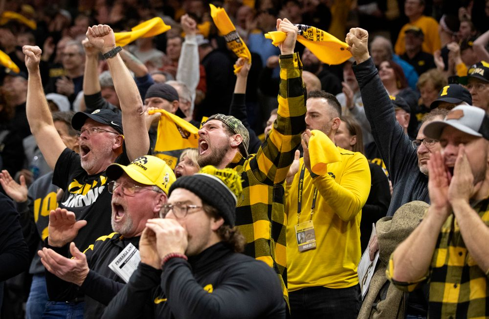 Iowa fans celebrate as Michael Kemerer defeats Penn State's Mark Hall in his 174-pound match during their dual at Carver-Hawkeye Arena in Iowa City on Friday, January 31, 2020. (Stephen Mally/hawkeyesports.com)
