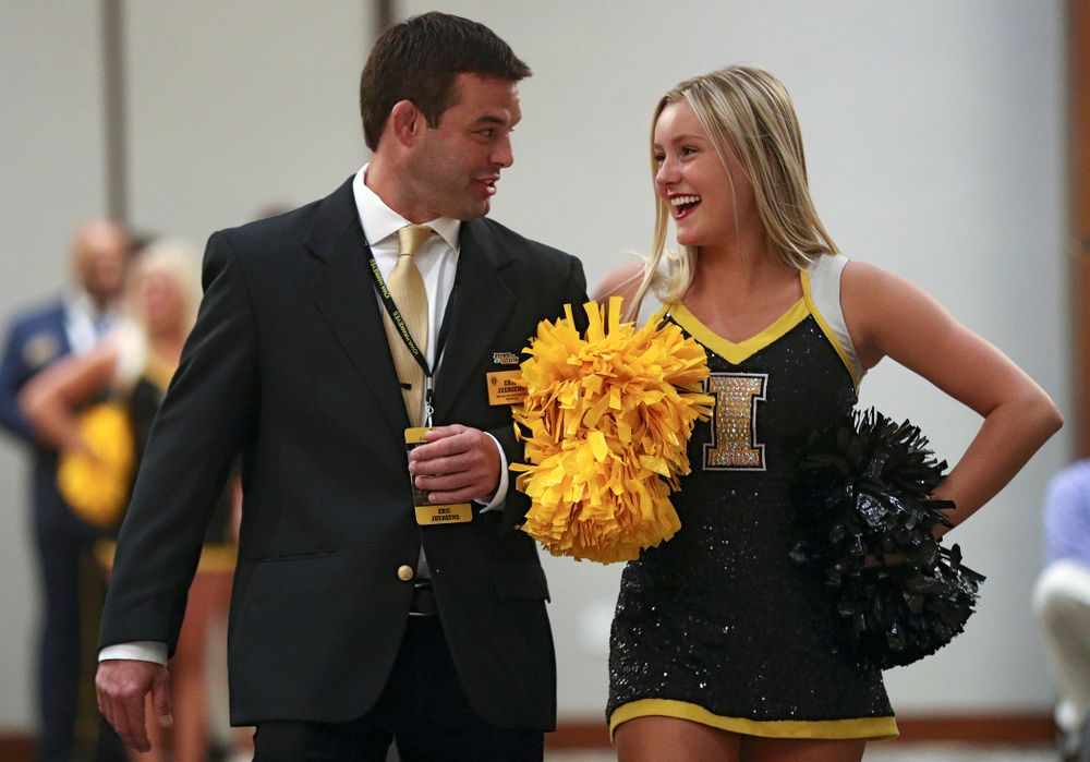2019 University of Iowa Athletics Hall of Fame inductee Eric Juergens walks to his seat with a Spirit Squad member during the Hall of Fame Induction Ceremony at the Coralville Marriott Hotel and Conference Center in Coralville on Friday, Aug 30, 2019. (Stephen Mally/hawkeyesports.com)
