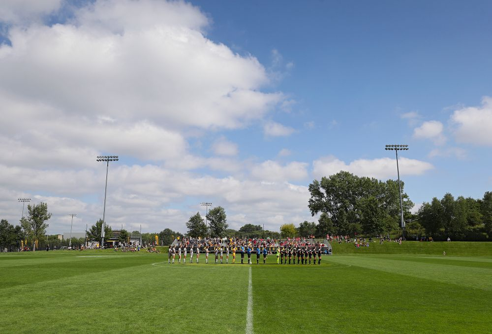 The Iowa Hawkeyes and Illinois State Redbirds stand for National Anthem before their match at the Iowa Soccer Complex in Iowa City on Sunday, Sep 1, 2019. (Stephen Mally/hawkeyesports.com)