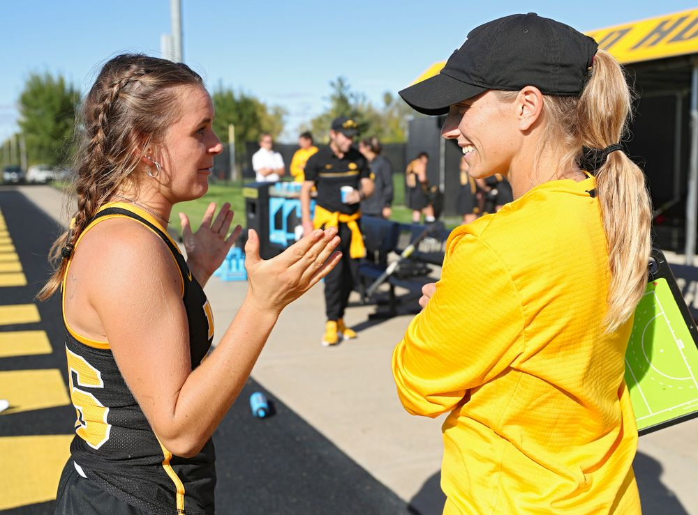 Iowa's Maddy Murphy (26) talks with assistant coach Roz Ellis after defeating Rutgers in their match at Grant Field in Iowa City on Friday, Oct 4, 2019. (Stephen Mally/hawkeyesports.com)