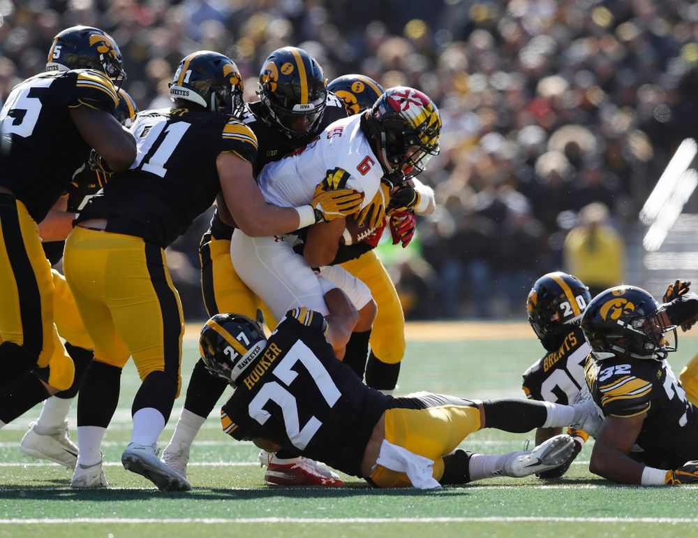 Iowa Hawkeyes defensive end Chauncey Golston (57), defensive lineman Brady Reiff (91), and defensive back Amani Hooker (27) against the Maryland Terrapins Saturday, October 20, 2018 at Kinnick Stadium (Brian Ray/hawkeyesports.com)