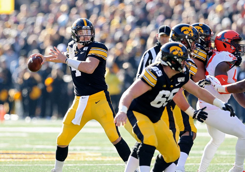 Iowa Hawkeyes quarterback Nate Stanley (4) looks to throw during the second quarter of their game at Kinnick Stadium in Iowa City on Saturday, Nov 23, 2019. (Stephen Mally/hawkeyesports.com)
