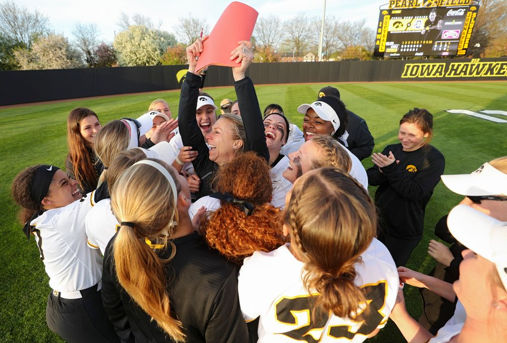 Iowa volunteer assistant coach Lori Duncan celebrates with players after winning their game against Ohio State at Pearl Field in Iowa City on Friday, May. 3, 2019. (Stephen Mally/hawkeyesports.com)