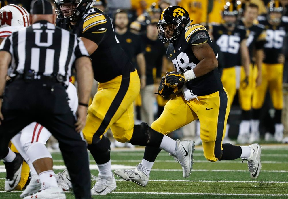 Iowa Hawkeyes running back Toren Young (28) runs the ball during a game against Wisconsin at Kinnick Stadium on September 22, 2018. (Tork Mason/hawkeyesports.com)