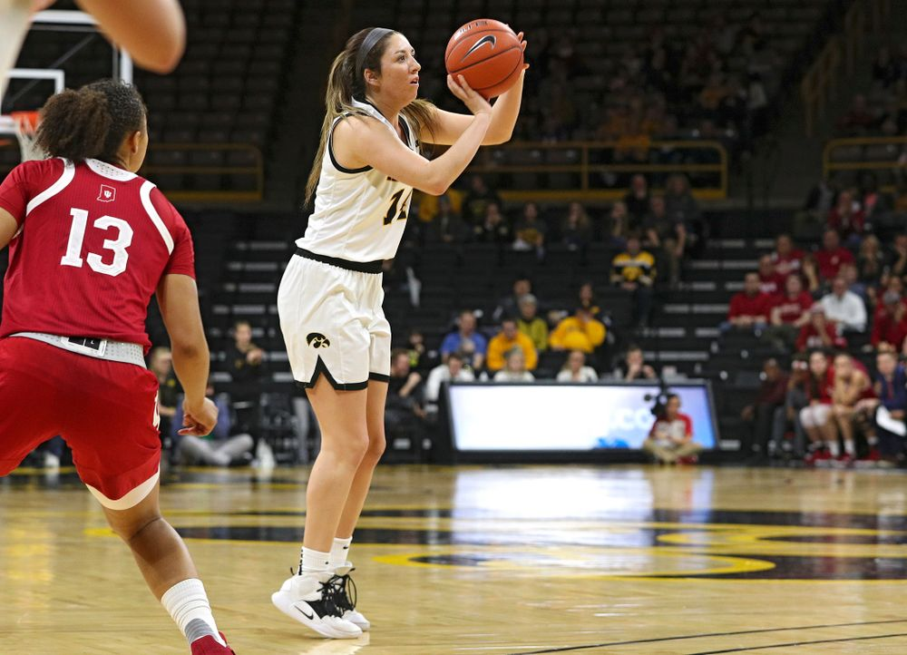 Iowa Hawkeyes guard Gabbie Marshall (24) makes a 3-pointer during the third quarter of their game at Carver-Hawkeye Arena in Iowa City on Sunday, January 12, 2020. (Stephen Mally/hawkeyesports.com)