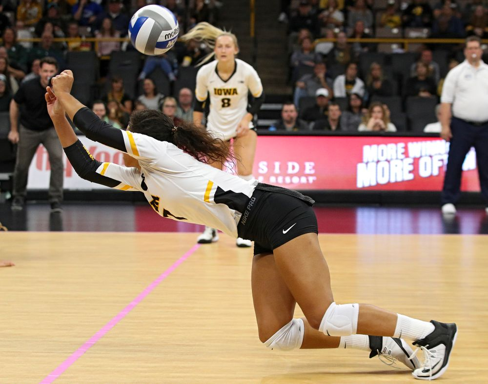 Iowa's Brie Orr (7) dives for the ball during the second set of their volleyball match at Carver-Hawkeye Arena in Iowa City on Sunday, Oct 13, 2019. (Stephen Mally/hawkeyesports.com)