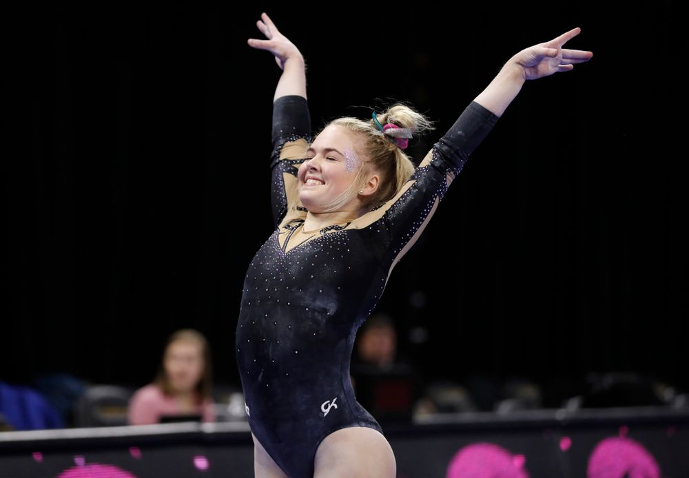 Iowa's Charlotte Sullivan competes on the beam