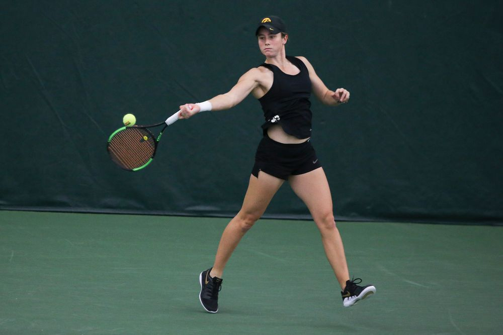 Iowa's Elise van Heuvelen returns a hit during the Iowa women's tennis meet vs DePaul  on Friday, February 21, 2020 at the Hawkeye Tennis and Recreation Complex. (Lily Smith/hawkeyesports.com)