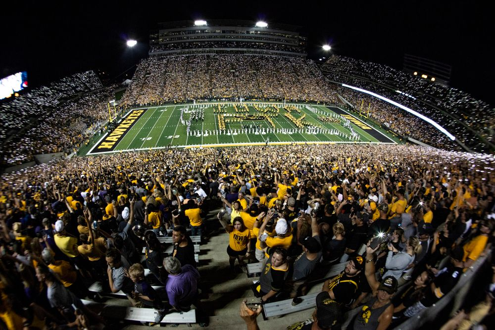 """Fans wave their cell phone lights as country artist Pat Green performs """"Wave on Wave"""" during halftime of the Iowa Hawkeyes game against the Northern Iowa Panthers Saturday, September 15, 2018 at Kinnick Stadium. (Brian Ray/hawkeyesports.com)"""