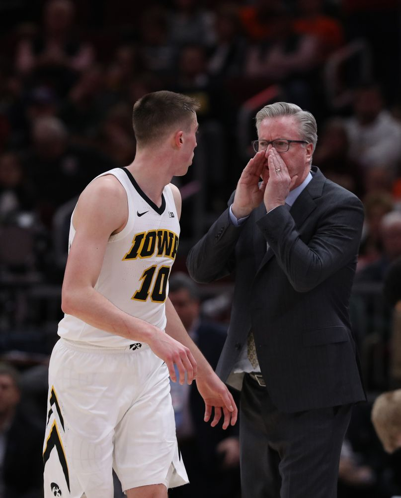 Iowa Hawkeyes head coach Fran McCaffery and guard Joe Wieskamp (10) against the Illinois Fighting Illini in the 2019 Big Ten Men's Basketball Tournament Thursday, March 14, 2019 at the United Center in Chicago. (Brian Ray/hawkeyesports.com)