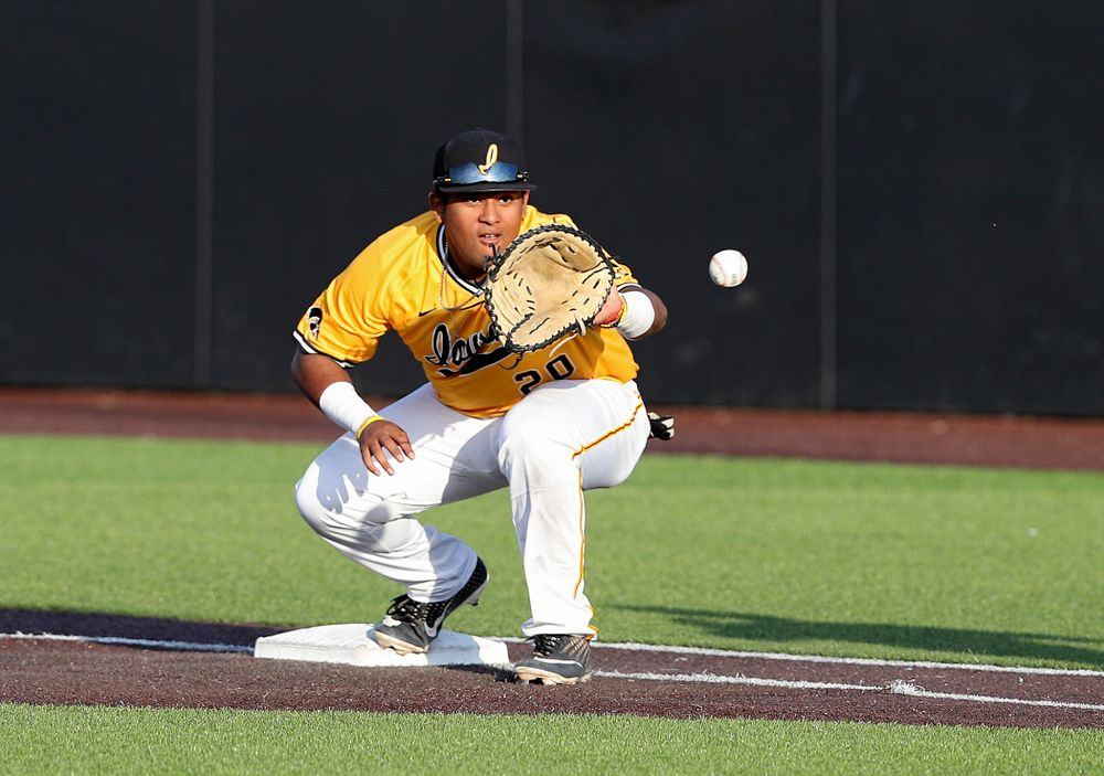 Iowa Hawkeyes first baseman Izaya Fullard (20) pulls in a throw for an out during the seventh inning of their game against Northern Illinois at Duane Banks Field in Iowa City on Tuesday, Apr. 16, 2019. (Stephen Mally/hawkeyesports.com)