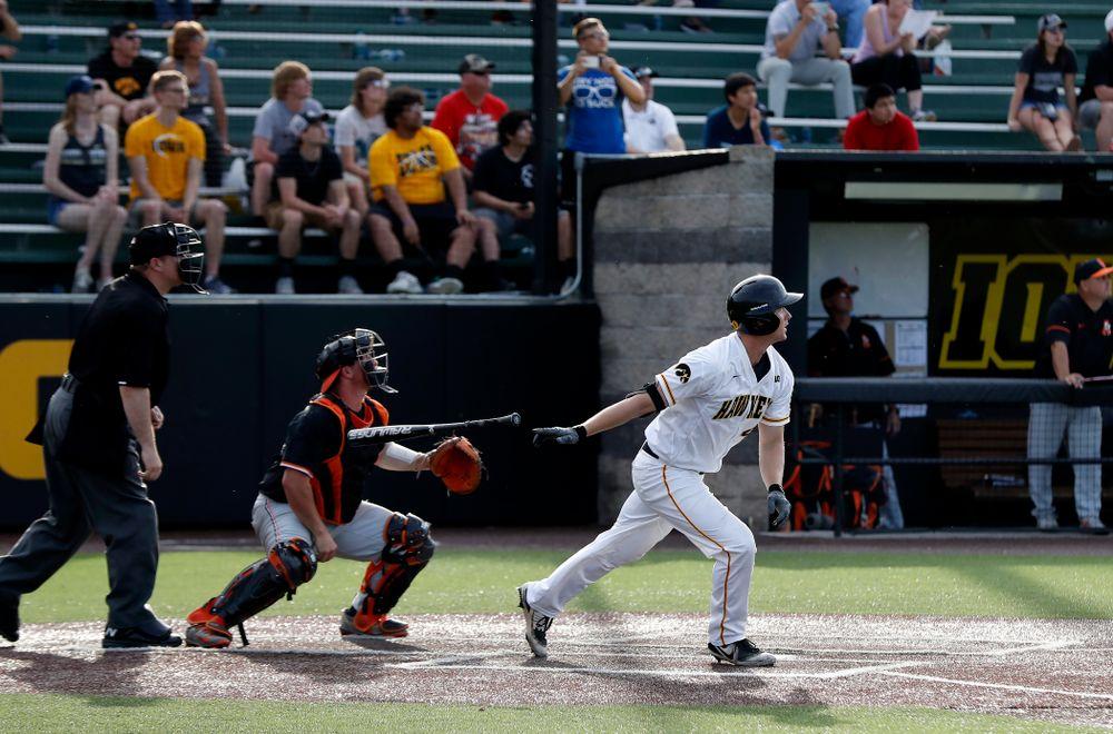 Iowa Hawkeyes outfielder Robert Neustrom (44) hits a three run home run against the Oklahoma State Cowboys Saturday, May 5, 2018 at Duane Banks Field. (Brian Ray/hawkeyesports.com)
