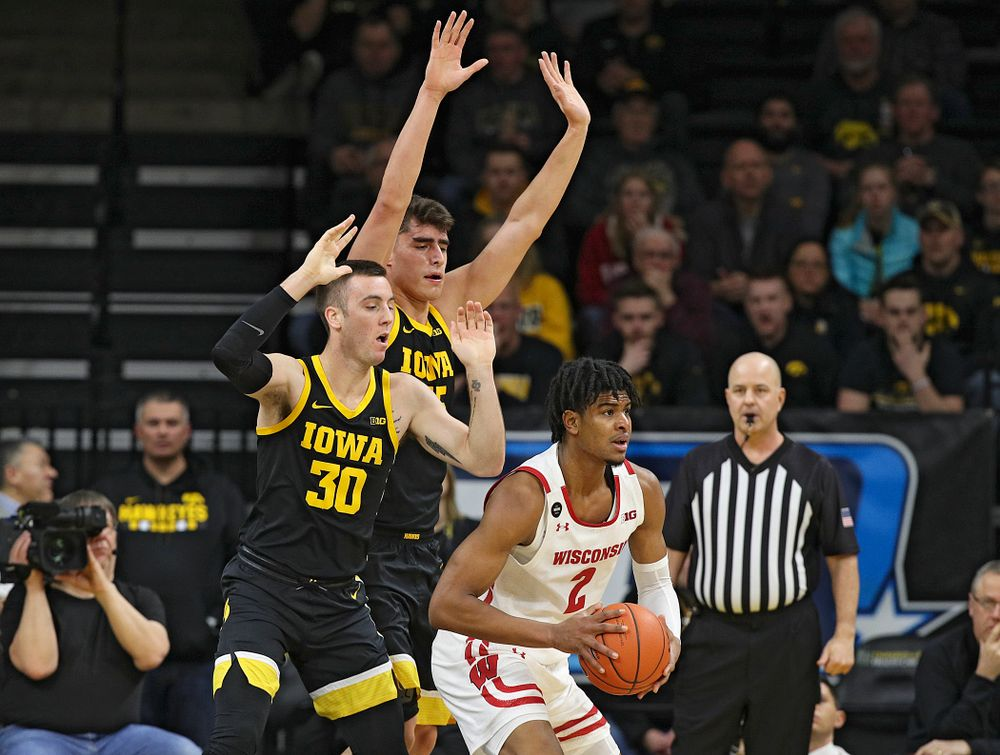 Iowa Hawkeyes guard Connor McCaffery (30) and center Luka Garza (55) pressure Wisconsin Badgers forward Aleem Ford (2) during the first half of their game at Carver-Hawkeye Arena in Iowa City on Monday, January 27, 2020. (Stephen Mally/hawkeyesports.com)