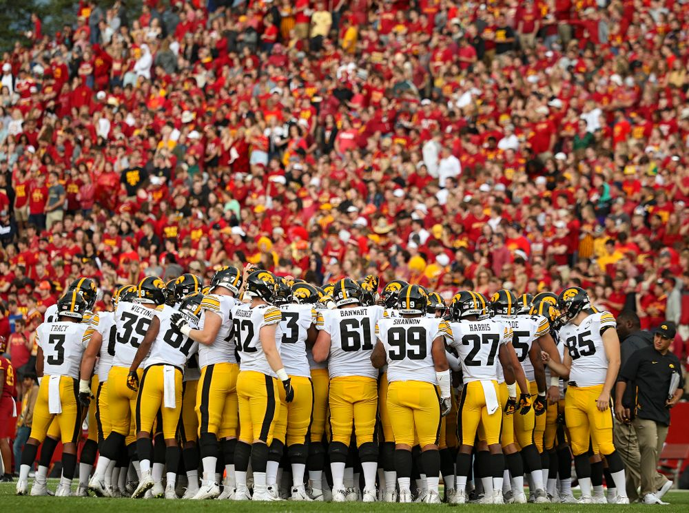 The Iowa Hawkeyes huddle after warming up following a weather delay during the first quarter of their Iowa Corn Cy-Hawk Series game at Jack Trice Stadium in Ames on Saturday, Sep 14, 2019. (Stephen Mally/hawkeyesports.com)