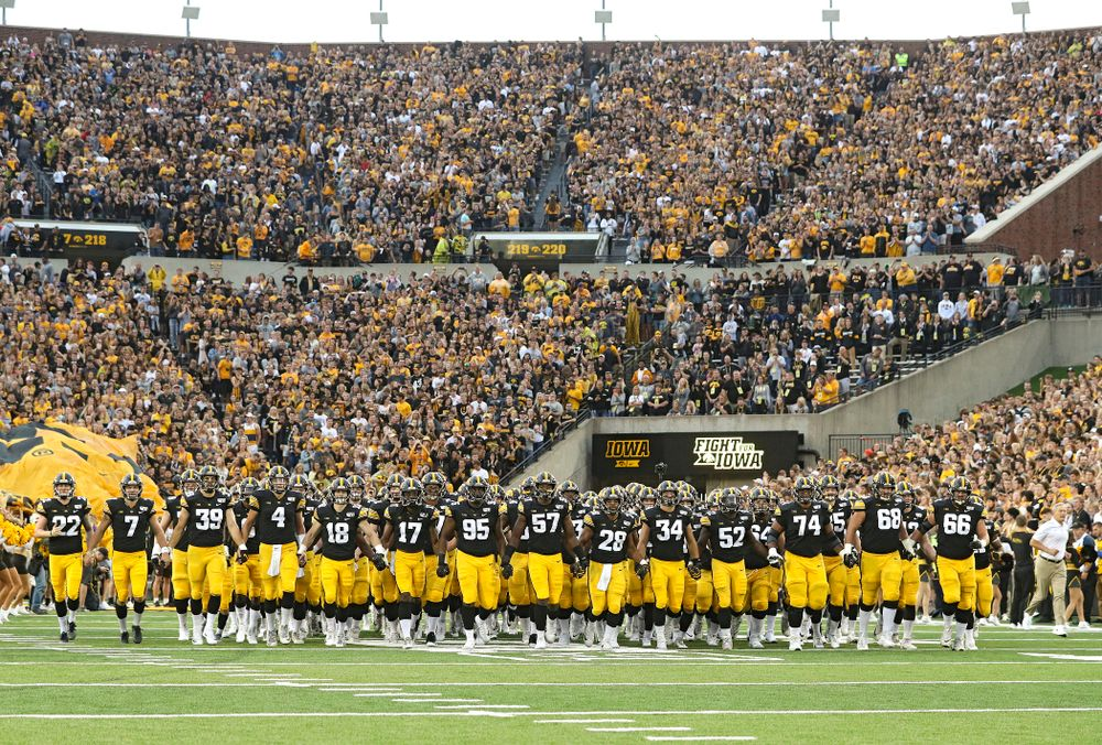 The Hawkeyes swarm as they take the field for their game at Kinnick Stadium in Iowa City on Saturday, Aug 31, 2019. (Stephen Mally/hawkeyesports.com)