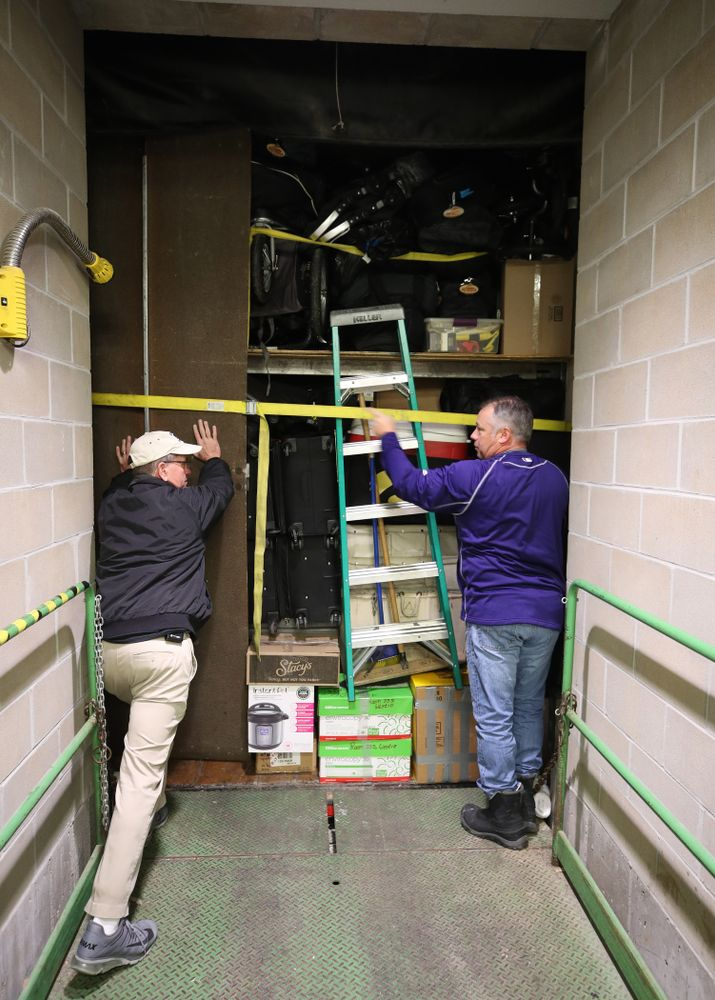 Hawkeye Football equipment managers Greg Morris and Kevin Foor prepare to close the doors on Hawk One before its departure for the Outback Bowl in Tampa, Florida  Friday, December 21, 2018 at the Hansen Football Performance Center. (Brian Ray/hawkeyesports.com)