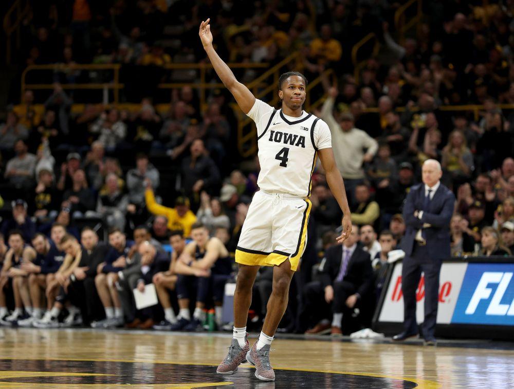 Iowa Hawkeyes guard Bakari Evelyn (4) celebrates a three point basket against Penn State Saturday, February 29, 2020 at Carver-Hawkeye Arena. (Brian Ray/hawkeyesports.com)