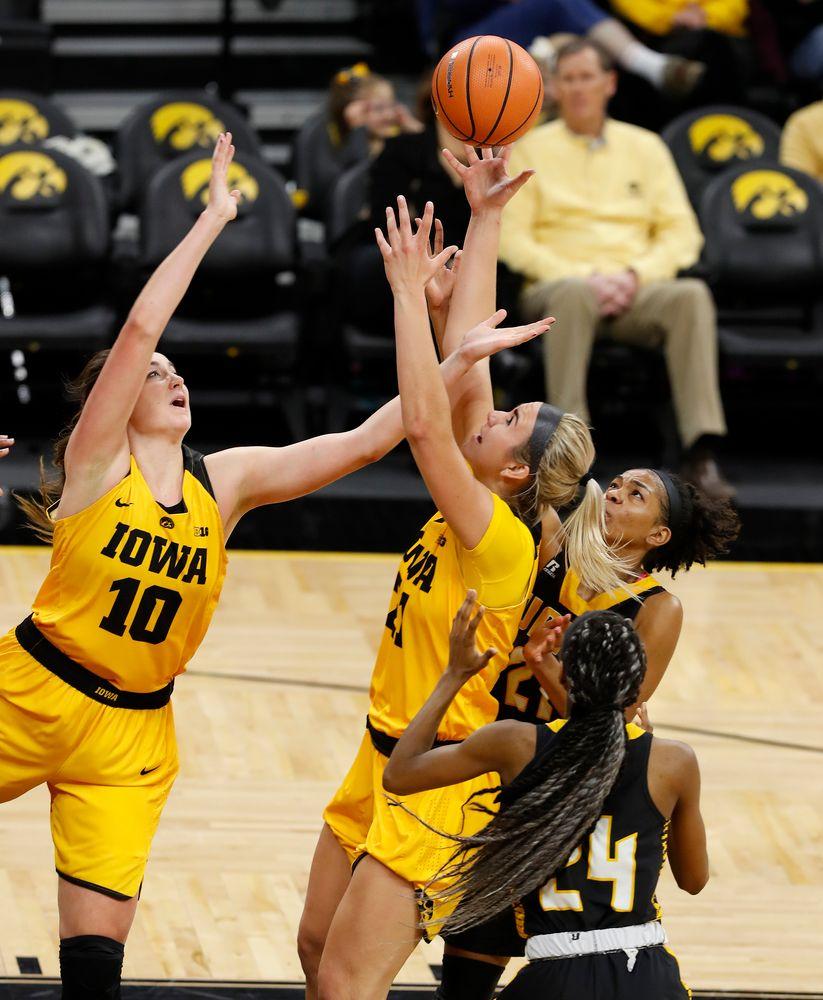 Iowa Hawkeyes forward Megan Gustafson (10) and forward Hannah Stewart (21)