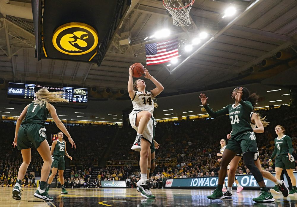 Iowa Hawkeyes guard Mckenna Warnock (14) scores a basket during the fourth quarter of their game at Carver-Hawkeye Arena in Iowa City on Sunday, January 26, 2020. (Stephen Mally/hawkeyesports.com)
