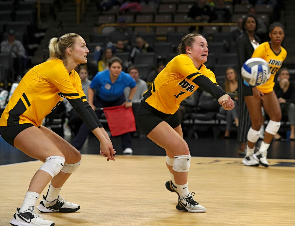 Iowa's Joslyn Boyer (1) gets a dig as Kyndra Hansen (8) looks on during the second set of their match against Illinois at Carver-Hawkeye Arena in Iowa City on Wednesday, Nov 6, 2019. (Stephen Mally/hawkeyesports.com)
