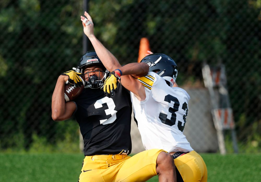 Iowa Hawkeyes wide receiver Tyrone Tracy Jr. (3) and defensive back Riley Moss (33) during camp practice No. 16 Tuesday, August 21, 2018 at the Hansen Football Performance Center. (Brian Ray/hawkeyesports.com)