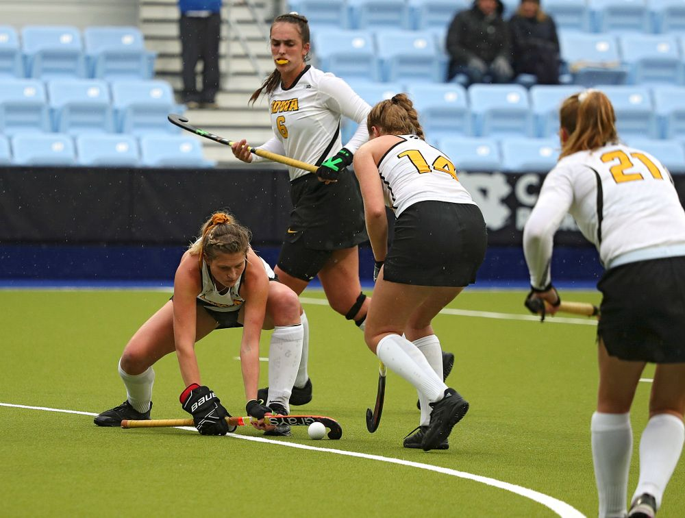 Iowa's Ellie Holley (7) positions the ball for Lokke Stribos (14) on a penalty corner during the second quarter of their NCAA Tournament First Round match against Duke at Karen Shelton Stadium in Chapel Hill, N.C. on Friday, Nov 15, 2019. (Stephen Mally/hawkeyesports.com)
