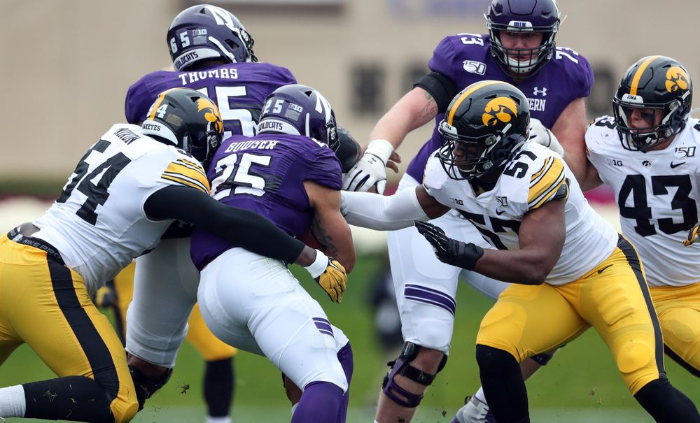 Iowa Hawkeyes defensive tackle Daviyon Nixon (54) and defensive end Chauncey Golston (57) against the Northwestern Wildcats Saturday, October 26, 2019 at Ryan Field in Evanston, Ill. (Brian Ray/hawkeyesports.com)