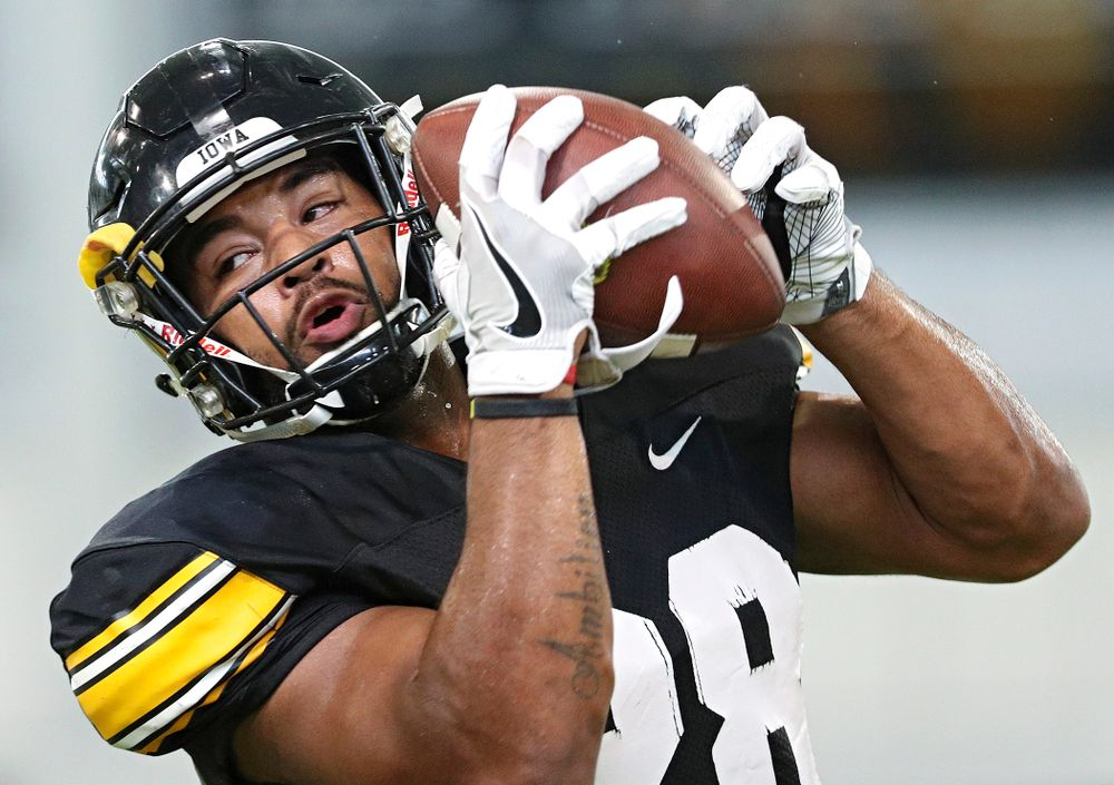 Iowa Hawkeyes running back Toren Young (28) pulls in a pass during Fall Camp Practice No. 6 at the Hansen Football Performance Center in Iowa City on Thursday, Aug 8, 2019. (Stephen Mally/hawkeyesports.com)