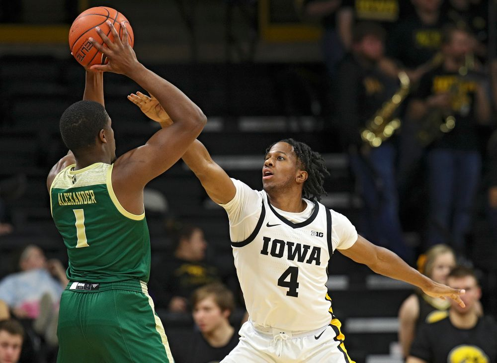 Iowa Hawkeyes guard Bakari Evelyn (4) defends during the second half of their game at Carver-Hawkeye Arena in Iowa City on Sunday, Nov 24, 2019. (Stephen Mally/hawkeyesports.com)
