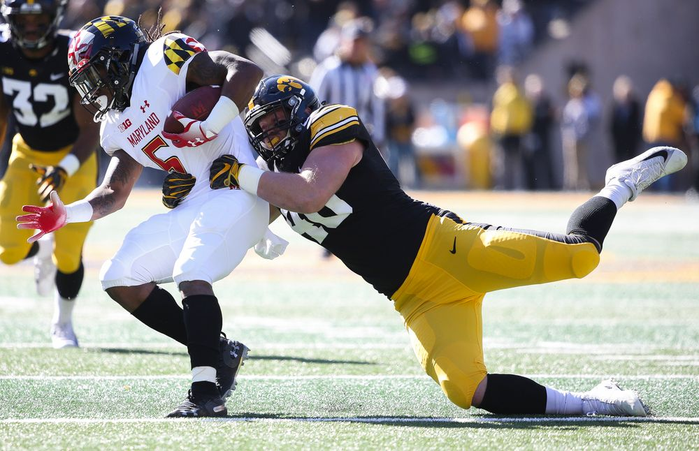 Iowa Hawkeyes defensive end Parker Hesse (40) makes a tackle for loss during a game against Maryland at Kinnick Stadium on October 20, 2018. (Tork Mason/hawkeyesports.com)