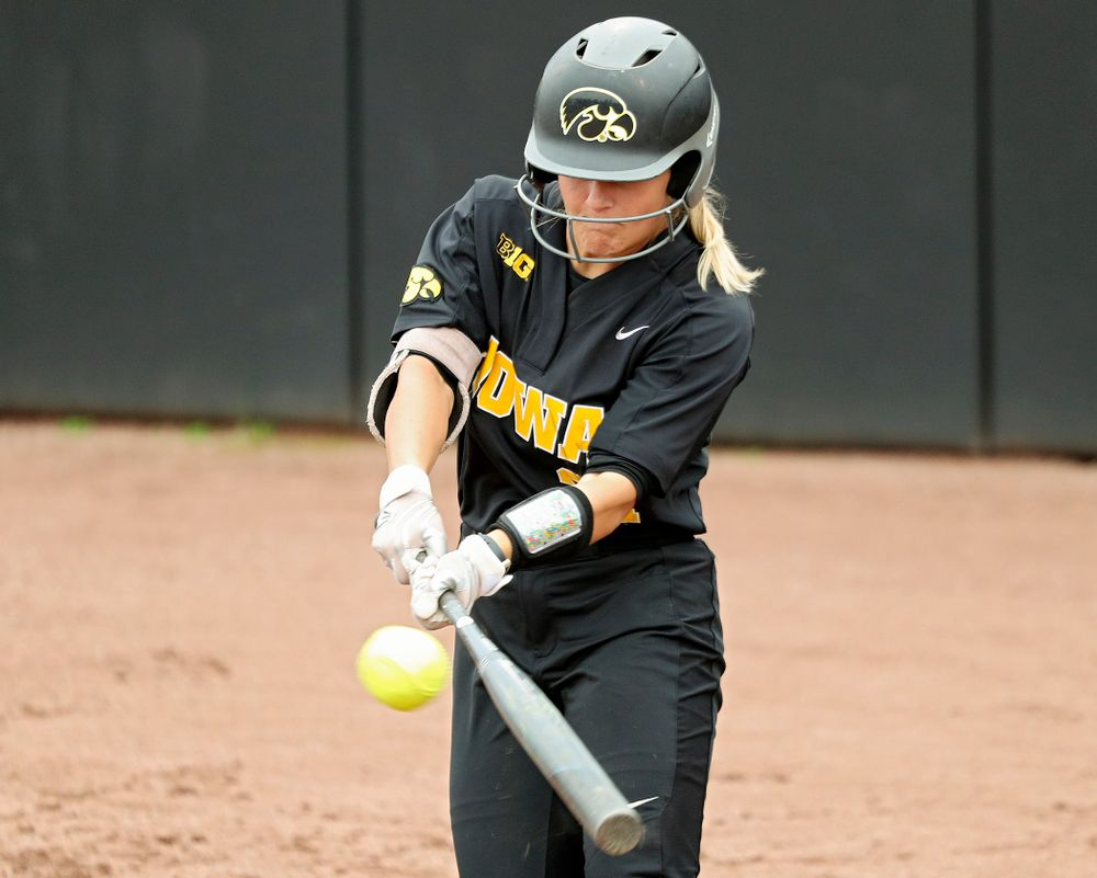 Iowa outfielder Havyn Monteer (21) drives a pitch for a hit during the fourth inning of their game against Iowa Softball vs Indian Hills Community College at Pearl Field in Iowa City on Sunday, Oct 6, 2019. (Stephen Mally/hawkeyesports.com)