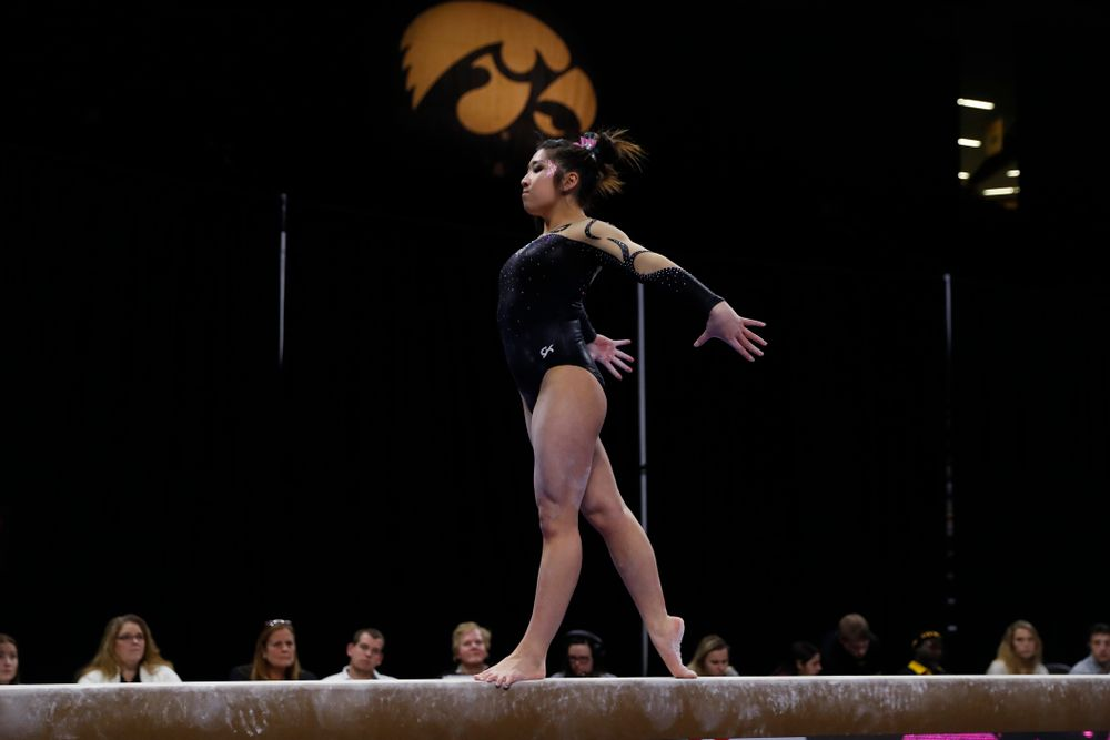 Iowa's Nicole Chow competes on the beam