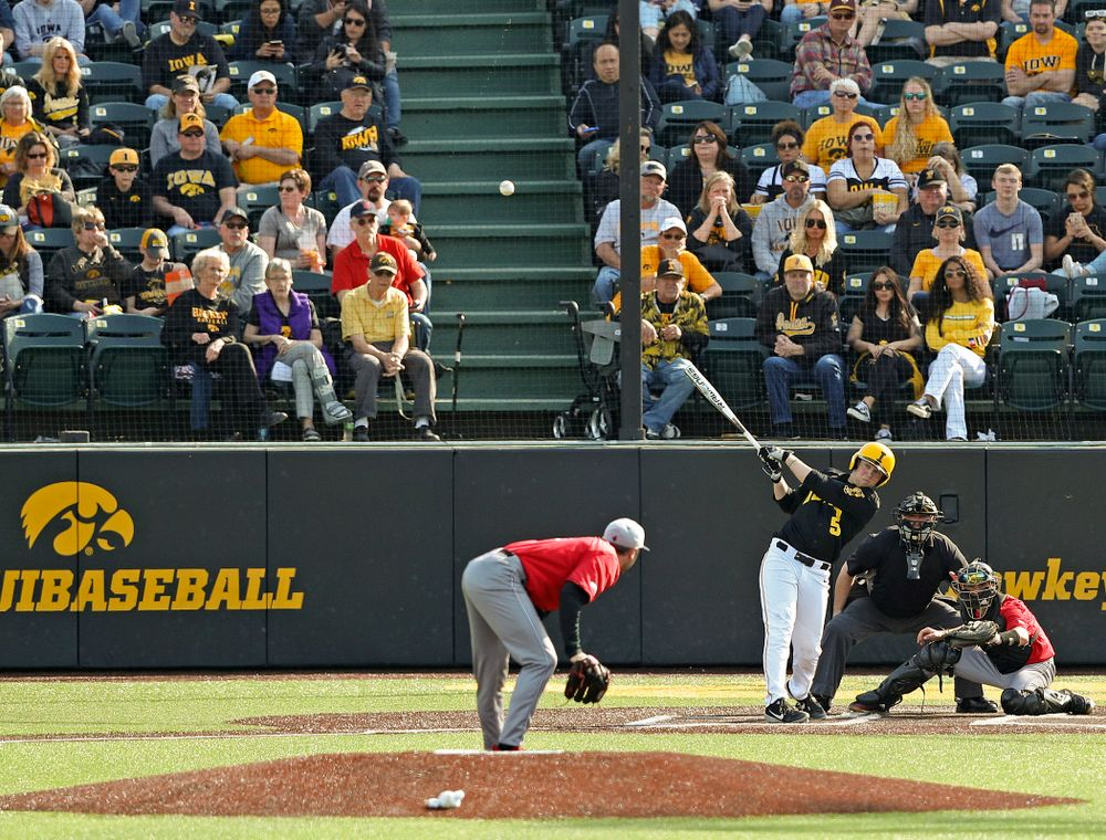 Iowa Hawkeyes first baseman Zeb Adreon (5) hits a 2-run double during the seventh inning of their game against Rutgers at Duane Banks Field in Iowa City on Saturday, Apr. 6, 2019. (Stephen Mally/hawkeyesports.com)